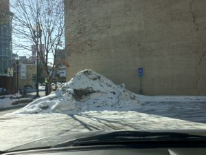 Pile of snow left in the disability parking area