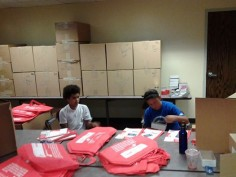 Two young people stuffing St. Fair Bags for MSCOD