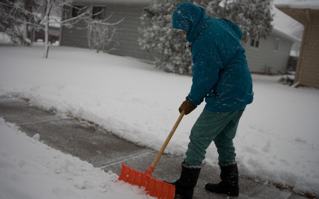 Man shoveling his sidewalk