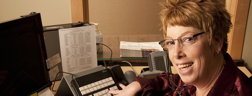 Woman using an adaptive keyboard at work