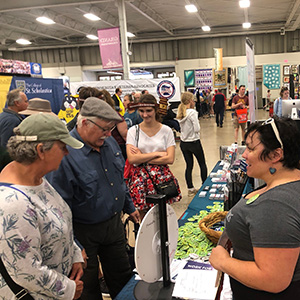 Commissioner Rebecca Lucero (MDHR) greet visitors at the Minnesota State Fair