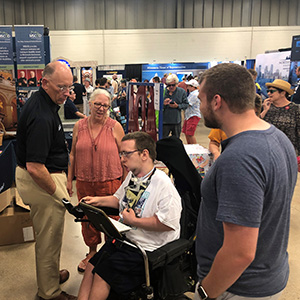 Commissioner Paul Schnell greets a visitor at the Minnesota State Fair