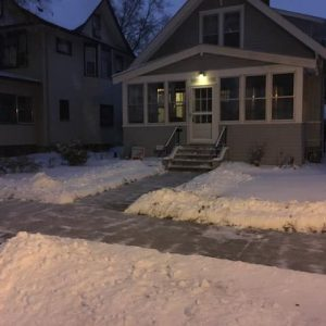 Completely cleared sidewalk in front of a house.